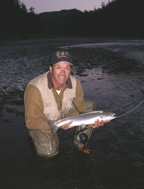 Angler with wild Klamath River Steelhead (released).