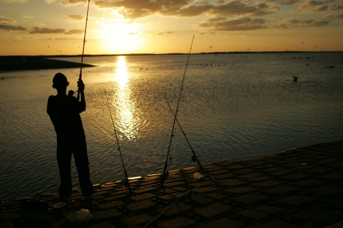 When fishing at night, make sure you can still identify your catch. (USFWS photo by Steve Hillebrand)