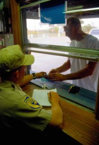 Check station employee checking hunter paperwork
